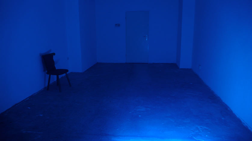 blue room with one stool